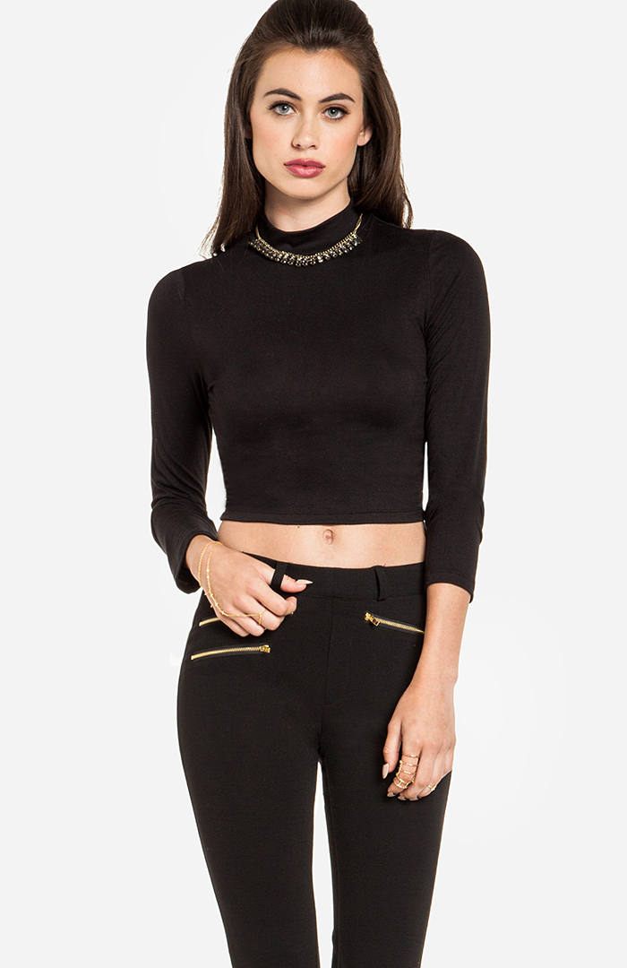 """BEST FOR: This fitted turtleneck works as a warm, layering piece USERS SAID: """"Got this turtleneck in Black. It's excellent, super soft and very VERY slimming."""